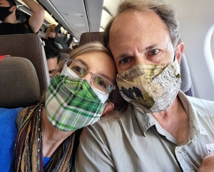 On the airplane! Mask up!
